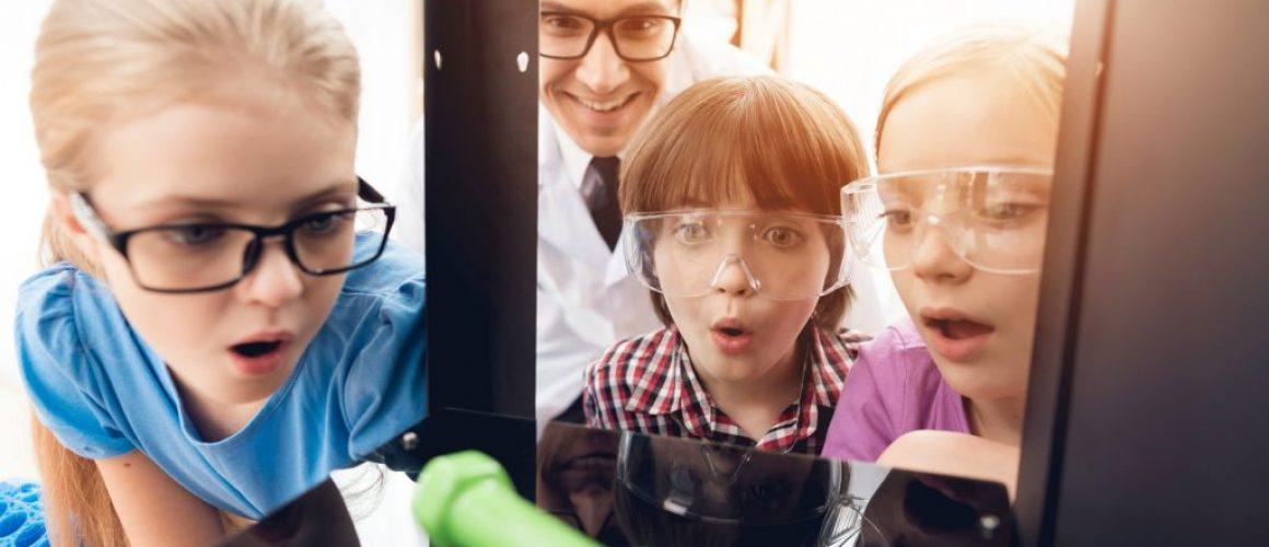 Children with teacher look like 3d printer printed dumbbell.